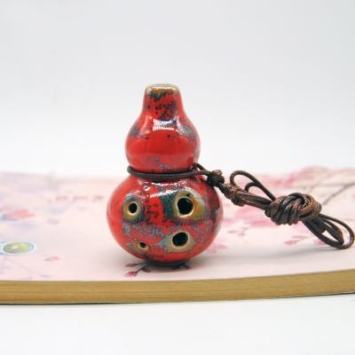 景瓷小鱼款陶笛花釉红TD034